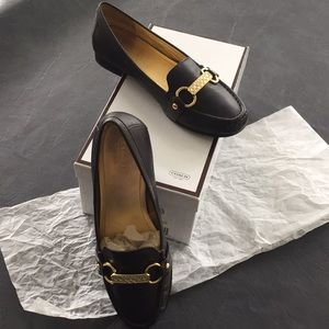 Coach brown flats. Great condition.